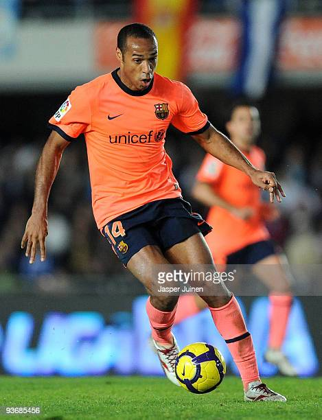 Thierry Henry of FC Barcelona runs with the ball during the La Liga match between Barcelona and Xerez at Estadio Municipal de Chapin on December 2...