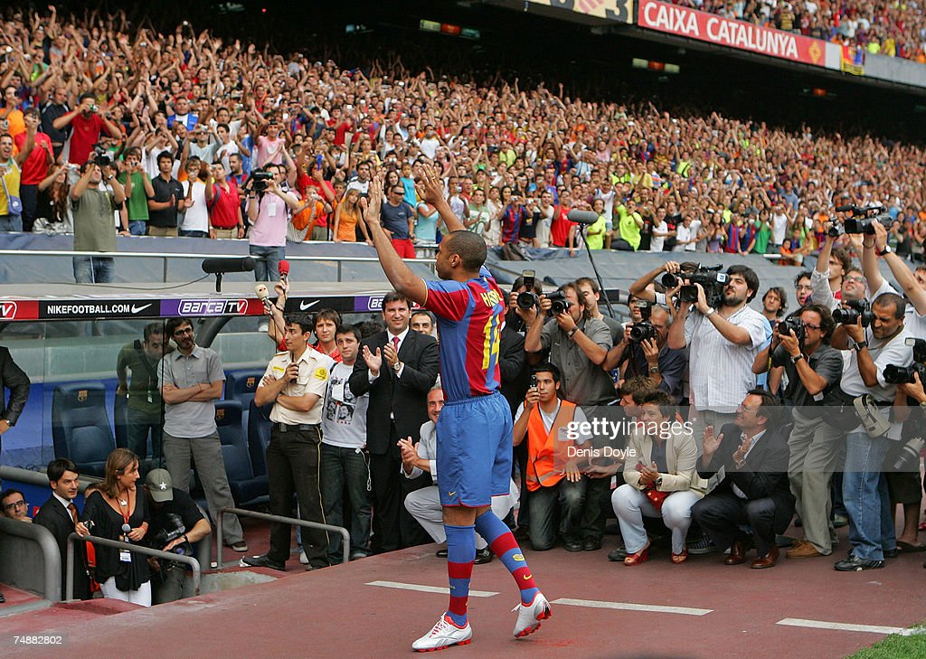 Thierry Henry of France applauds Barca fans at the Camp Nou stadium after signing for Barcelona on June 25, 2007 in Barcelona, Spain.