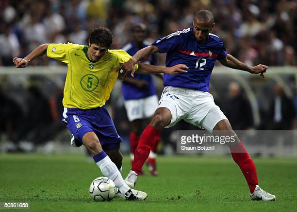 Thierry Henry of France battles with Edmilson of Brazil during the FIFA Centennial Match between France and Brazil at the Stade de France on May 20...