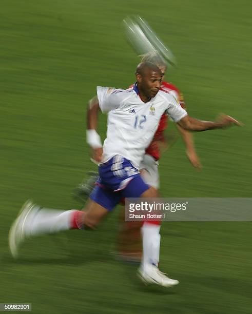 Thierry Henry of France breaks forward with the ball during the UEFA Euro 2004 Group B match between Switzerland and France at the Estadio Cidade de...