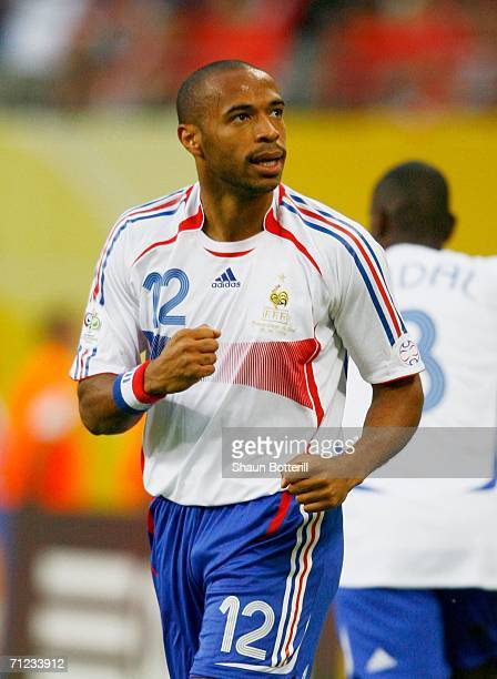 Thierry Henry of France celebrates scoring the opening goal during the FIFA World Cup Germany 2006 Group G match between France and Korea Republic...