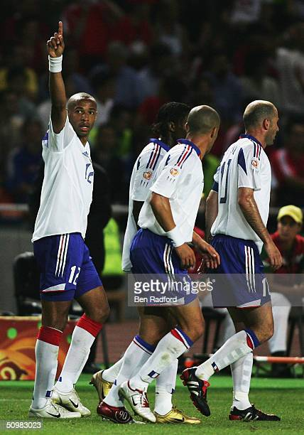 Thierry Henry of France celebrates scoring their third goal during the UEFA Euro 2004 Group B match between Switzerland and France at the Estadio...