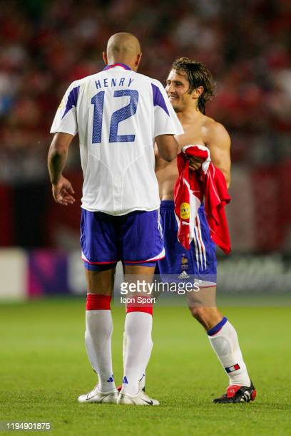 Thierry HENRY of France celebrates with Bixente LIZARAZU of France during the European Championship Pool B match between Switzerland and France at...