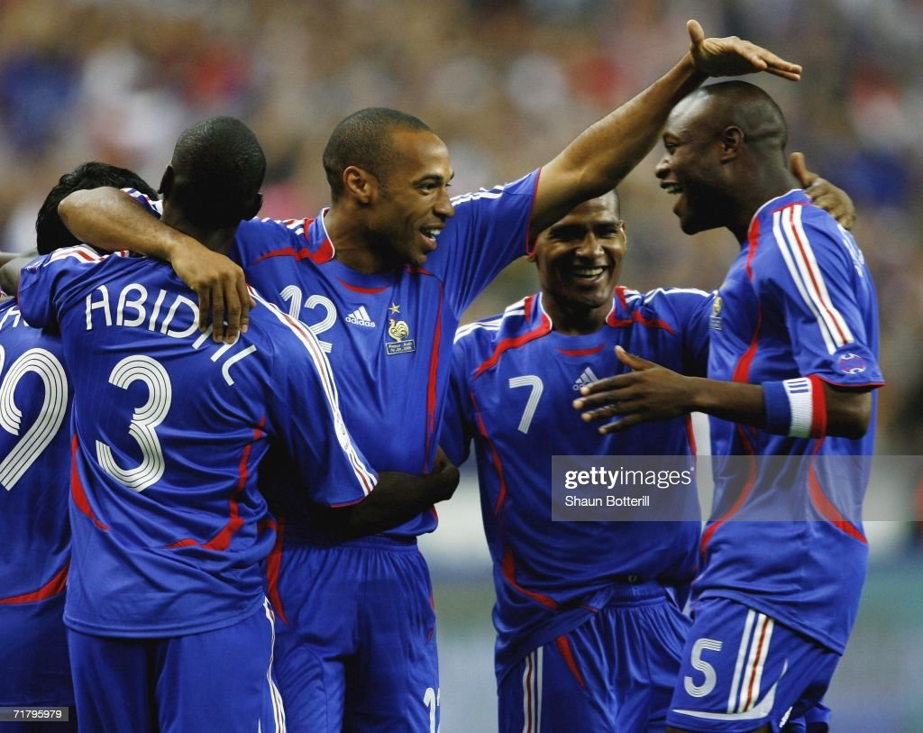 Thierry Henry (C) of France celebrates with team-mate William Gallas after the first goal during the Euro2008 Qualifing match between France and Italy at the Stade de France on September 6, 2006 in Paris, France.