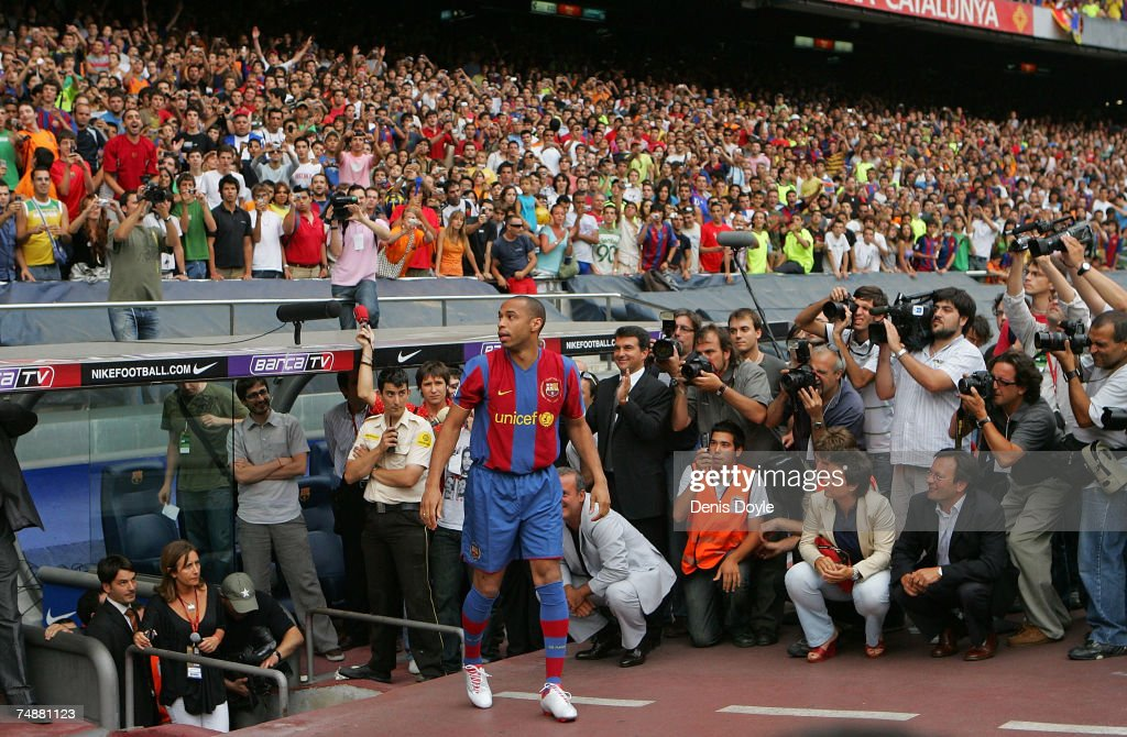 Thierry Henry of France enters the Camp Nou stadium after signing for Barcelona on June 25, 2007 in Barcelona, Spain.