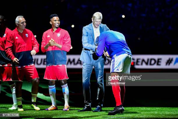 Thierry Henry of France greets his former Arsenal manager FIFA 98 coach Arsene Wenger before the Legends Game match between France 98 and Fifa 98 at...