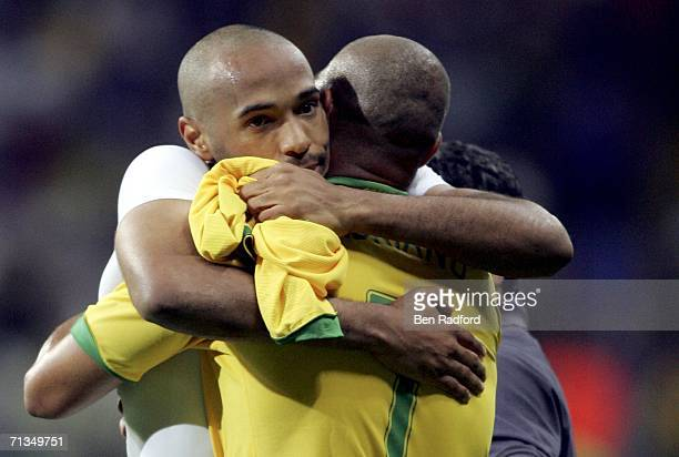 Thierry Henry of France hugs Adriano of Brazil following his team's 10 victory during the FIFA World Cup Germany 2006 Quarterfinal match between...