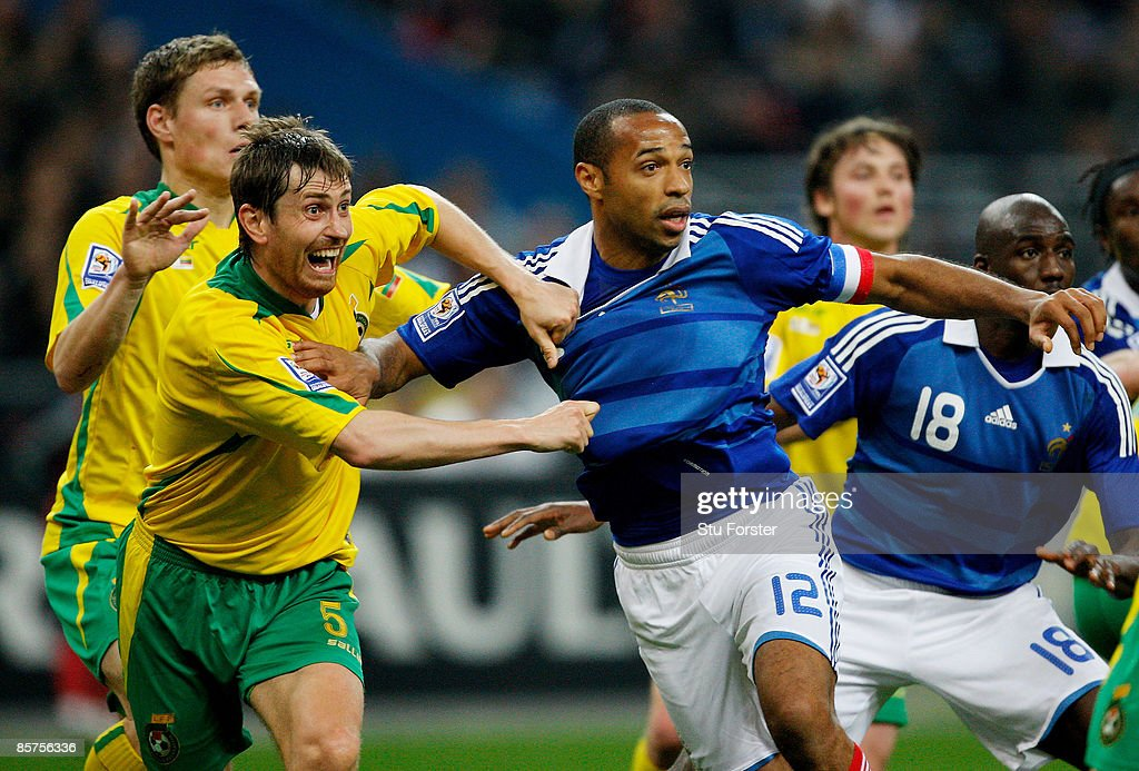 Thierry Henry of France is pulled back by Andrius Skerla of Lithuania during the group 7 FIFA2010 World Cup Qualifier between France and Lithuania at Saint Denis, Stade de France on April 1, 2009 in Paris, France.