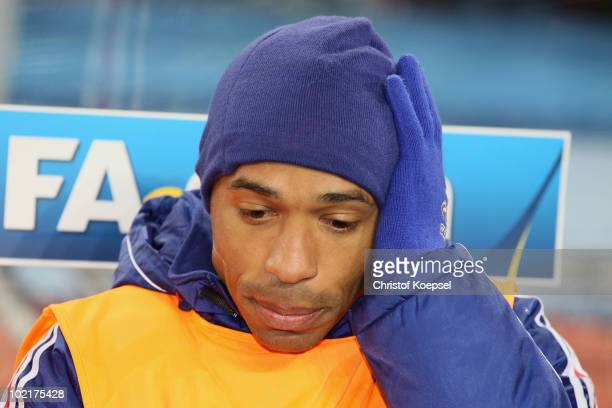 Thierry Henry of France occupies the substitutes bench prior to the 2010 FIFA World Cup South Africa Group A match between France and Mexico at the...