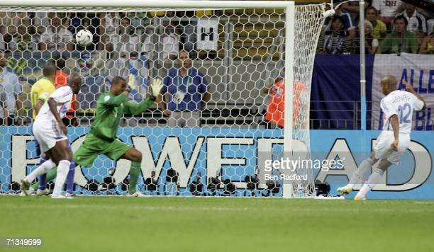 Thierry Henry of France scores the opening goal during the FIFA World Cup Germany 2006 Quarterfinal match between Brazil and France at the Stadium...