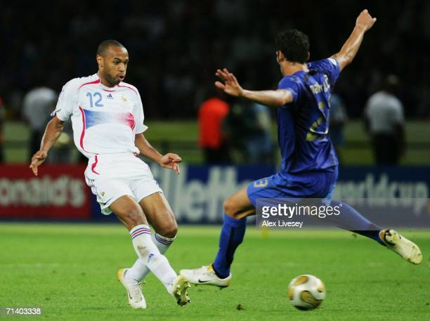 Thierry Henry of France shoots past Marco Materazzi of Italy during the FIFA World Cup Germany 2006 Final match between Italy and France at the...