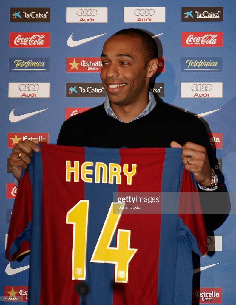 Thierry Henry of France shows his new Barcelona shirt at the ...