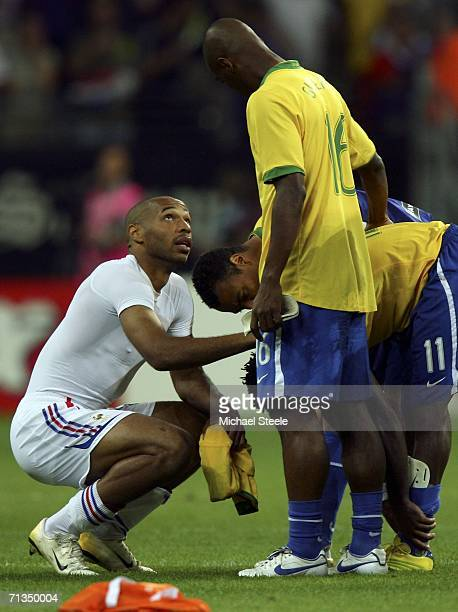 Thierry Henry of France speaks with dejected Brazilian players following France's 10 victory during the FIFA World Cup Germany 2006 Quarterfinal...