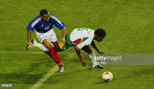 Thierry Henry of France takes on Aliou Cisse of Senegal during the France v Senegal Group A World Cup Group Stage match played at the Seoul World Cup...