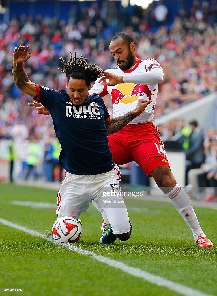 Thierry Henry #14 of New York Red Bulls knocks Jermaine Jones #13 of New England Revolution off the ball the during the Eastern Conference Final - Leg 1 at Red Bull Arena on November 23, 2014 in Harrison, New Jersey.