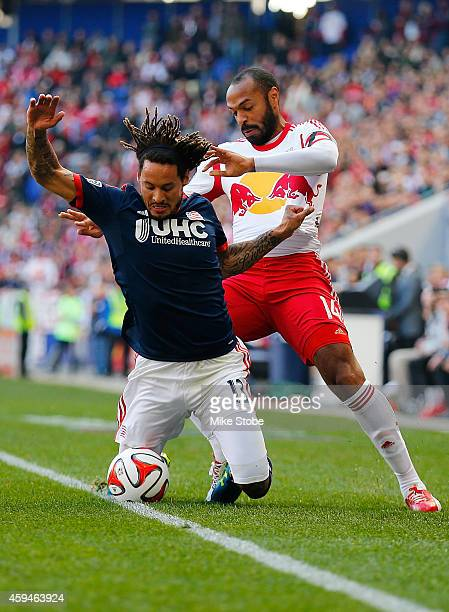 Thierry Henry of New York Red Bulls knocks Jermaine Jones of New England Revolution off the ball the during the Eastern Conference Final Leg 1 at Red...