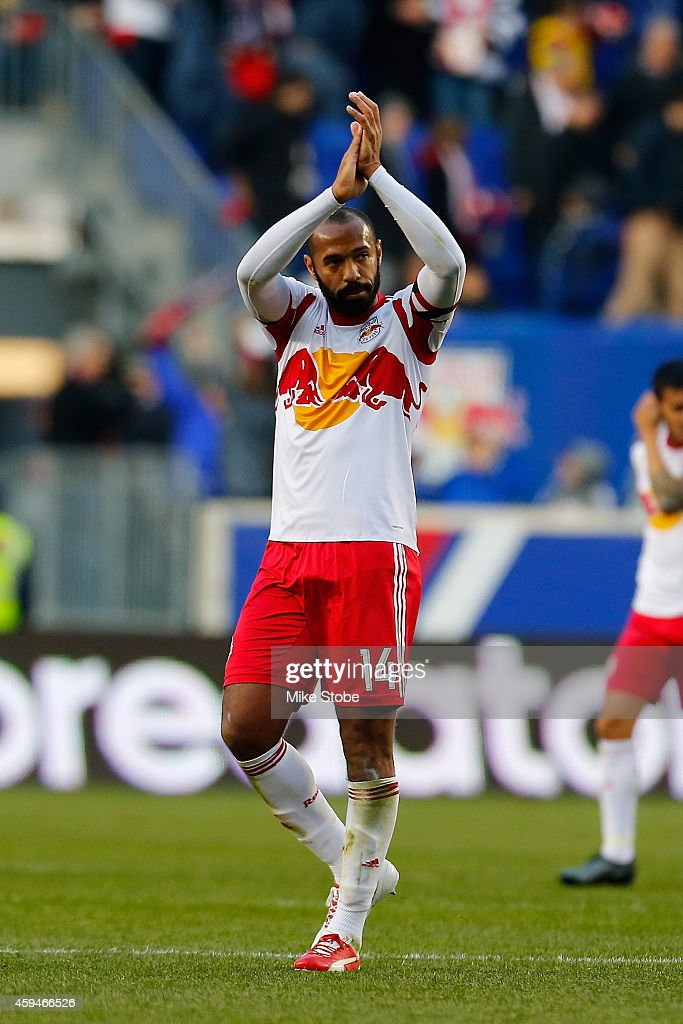 Thierry Henry #14 of New York Red Bulls salutes the crowd following their lose to the New England Revolution during the Eastern Conference Final - Leg 1 at Red Bull Arena on November 23, 2014 in Harrison, New Jersey.