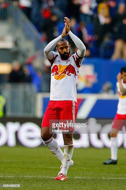 Thierry Henry of New York Red Bulls salutes the crowd following their lose to the New England Revolution during the Eastern Conference Final - Leg 1...