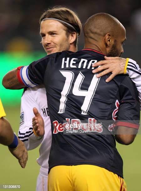 Thierry Henry of the New York Red Bulls and David Beckham of the Los Angeles Galaxy hug before playing in their Western Conference Semifinal at The...