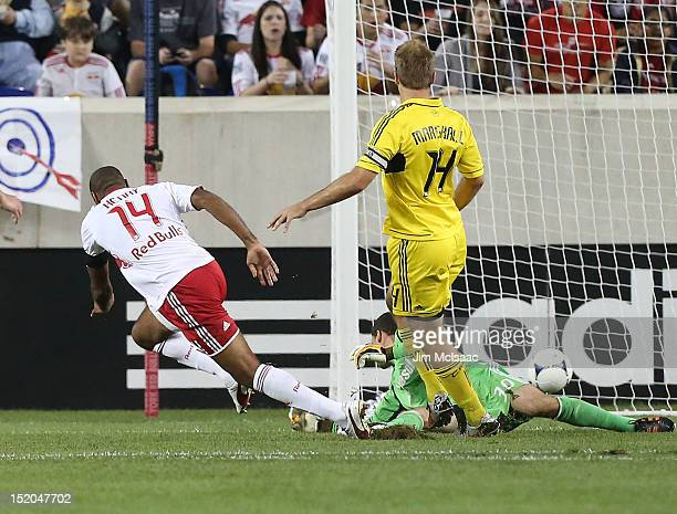 Thierry Henry of the New York Red Bulls scores a goal in the first half past Andy Gruenebaum of the Columbus Crew at Red Bull Arena on September 15...