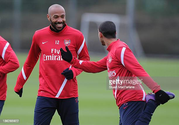 Thierry Henry of the New York Red Bulls with Theo Walcott of Arsenal during a training session at London Colney on December 30 2011 in St Albans...