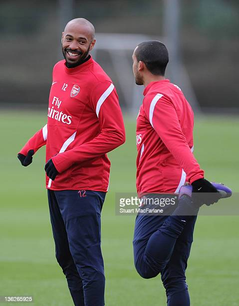 Thierry Henry of the New York Red Bulls with Theo Walcott of Arsenal during a training session at London Colney on December 30, 2011 in St Albans,...