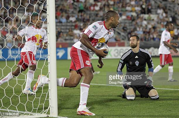 Thierry Henry of the New York Red collects the ball from the goal after scoring against goalkeeper Matt Pickens of the Colorado Rapids in the 67th...
