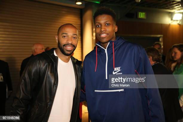 Thierry Henry poses with Frank Ntilikina of team Stephen during the NBA AllStar Game as a part of 2018 NBA AllStar Weekend at STAPLES Center on...