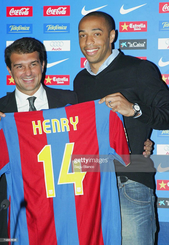 Thierry Henry poses with his new shirt and Joan Laporta during the press conference to announce Henry's signing with FC Barcelona, on June 25, 2007, in Barcelona, Spain. (Photo by Bagu Blanco/Getty Images).