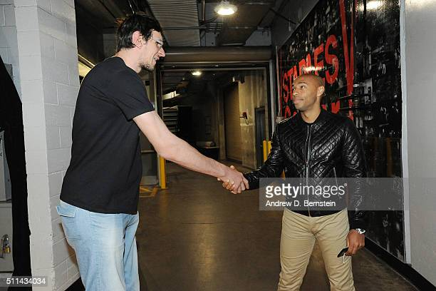 Thierry Henry shakes hands with Boban Marjanovic of the San Antonio Spurs before the game against the Los Angeles Lakers on February 19 2016 at...