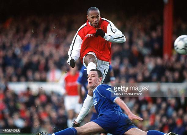 Thierry Henry shoots past John Terry during the Premiership match between Arsenal and Chelsea at the Emirates Stadium on January 13, 2001 in London,...