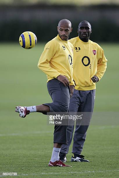 Thierry Henry shows his ball skills in front of Sol Campbell of Arsenal during training before Arsenals Champions League match against Sparta Prague...