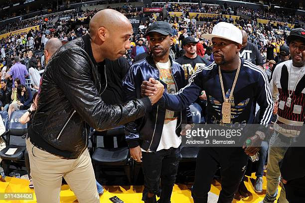 Thierry Henry talks with Floyd Mayweather Jr during the game between the Los Angeles Lakers and the San Antonio Spurs on February 19 2016 at STAPLES...