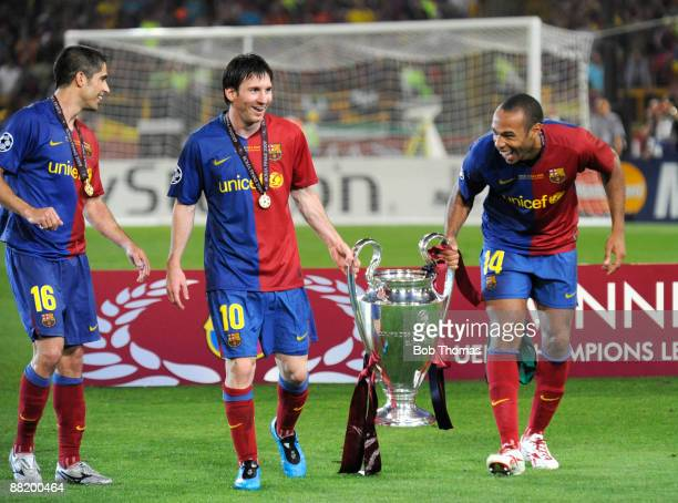 Thierry Henry with Lionel Messi and Sylvinho of Barcelona celebrate with the trophy after the UEFA Champions League Final match between Barcelona and...