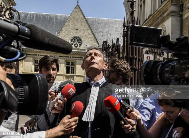 Thierry Moser, lawyer of Gregory's parents, answers journalists' questions upon his arrival at Dijon's courthouse, on June 20 prior to a hearing as...