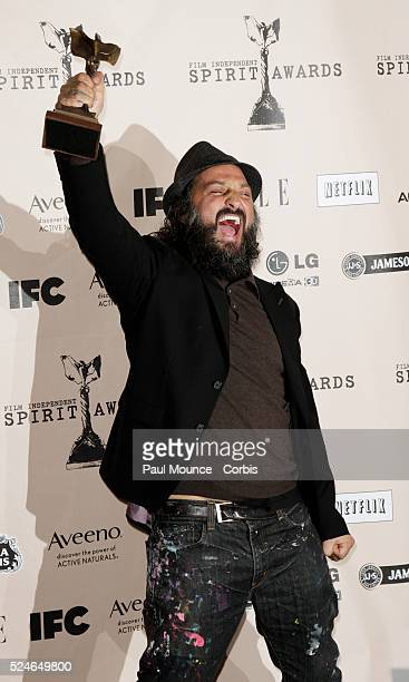 Thierry Mr Brainwash Guetta poses with the award won by the artist Bansky for Best Documentary in the press room at the 26th Annual Film Independent...