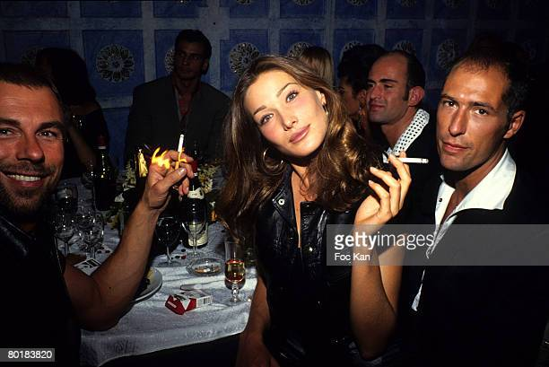 Thierry Mugler Carla Bruni and Chris Martin attend an After Fashion Show Party at the Bains Club on October 11991 in Paris France