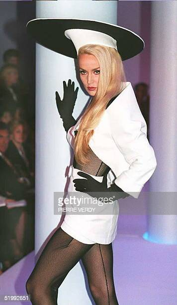 Thierry Mugler presents a cutaway jacket over a miniskirt doubled with shorts for the SpringSummer 1996 readytowear collection presented at his...