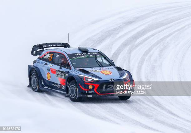 Thierry Neuville and his codriver Nicolas Gilsoul of Belgium drive their Hyundai i20 Coupe WRC car to win the Rally Sweden 2018 as part of the World...