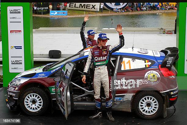 Thierry Neuville and Nicolas Gilsoul of Belgium celebrate third place during day three of FIA World Rally Championship Mexico on March 10 2013 in...