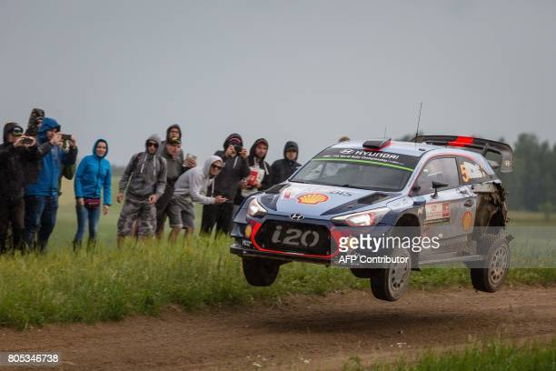 Thierry Neuville from Belgium and his codriver Nicolas Gilsoul steer their Hyundai i20 Coupe WRC during special stage of the Rally of Poland in...