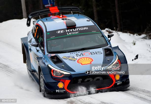 Thierry Neuville of Belgium and his codriver Nicolas Gilsoul compete in their Hyundai i20 Coupe WRC during the 5th stage of the Rally Sweden second...