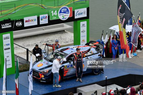 Thierry Neuville of Belgium and Nicolas Gilsoul of Belgium celebrate their third position in the overall during Day Three of the WRC Mexico on March...