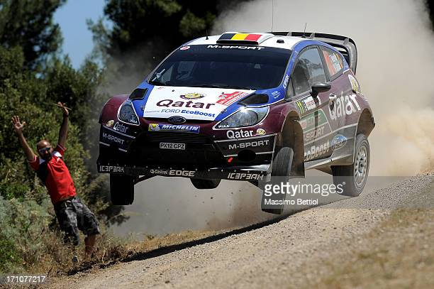 Thierry Neuville of Belgium and Nicolas Gilsoul of Belgium compete in their Qatar WRT Ford Fiesta RS WRC during Day One of the WRC Italy on June 21...
