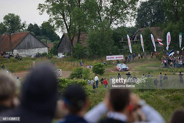 Thierry Neuville of Belgium and Nicolas Gilsoul of Belgium compete in their Hyundai Motorsport Hyundai i20 WRC during Day Three of the WRC Poland on...