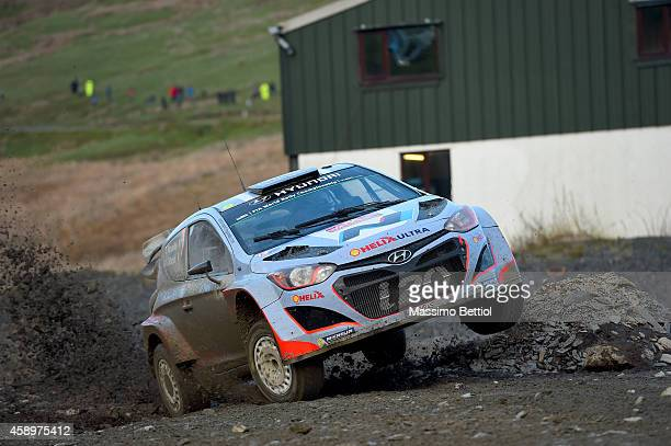 Thierry Neuville of Belgium and Nicolas Gilsoul of Belgium compete in their Hyundai Motorsport Hyundai i20 WRC during Day One of the WRC Great...