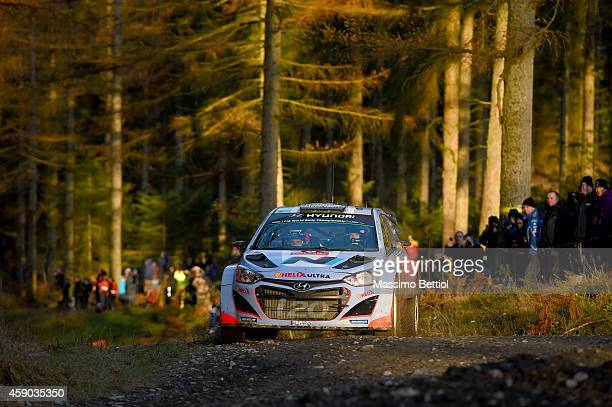 Thierry Neuville of Belgium and Nicolas Gilsoul of Belgium compete in their Hyundai Motorsport Hyundai i20 WRC during Day Two of the WRC Great...
