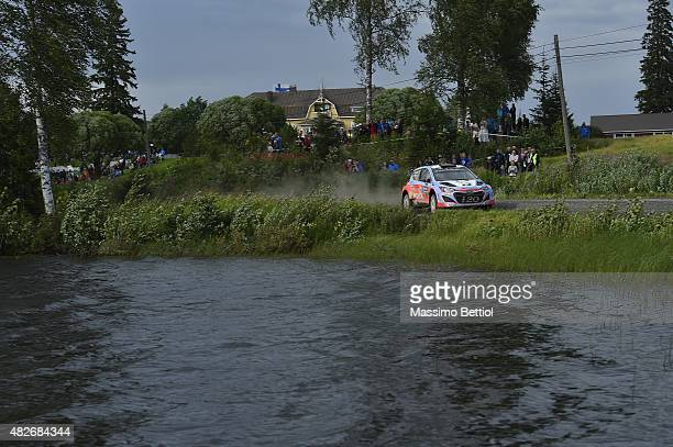 Thierry Neuville of Belgium and Nicolas Gilsoul of Belgium compete in their Hyundai Motorsport Hyundai i20 WRC during Day Two of the WRC Finland on...