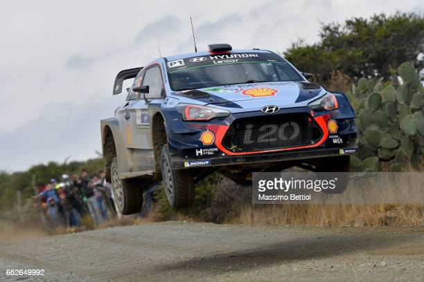 Thierry Neuville of Belgium and Nicolas Gilsoul of Belgium compete in their Hyundai Motorsport Hyundai i2o Coupè WRC during Day Three of the WRC...