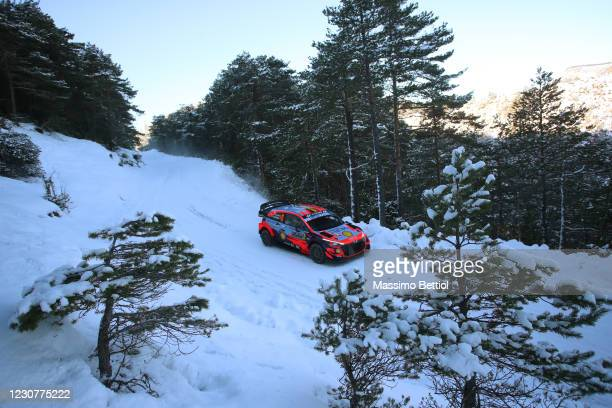 Thierry Neville and Martijn Wydaeghe of Belgium compete with their Hyundai Shell Mobis WRT Hyundai i20 Coupe WRC during day four of the FIA World...